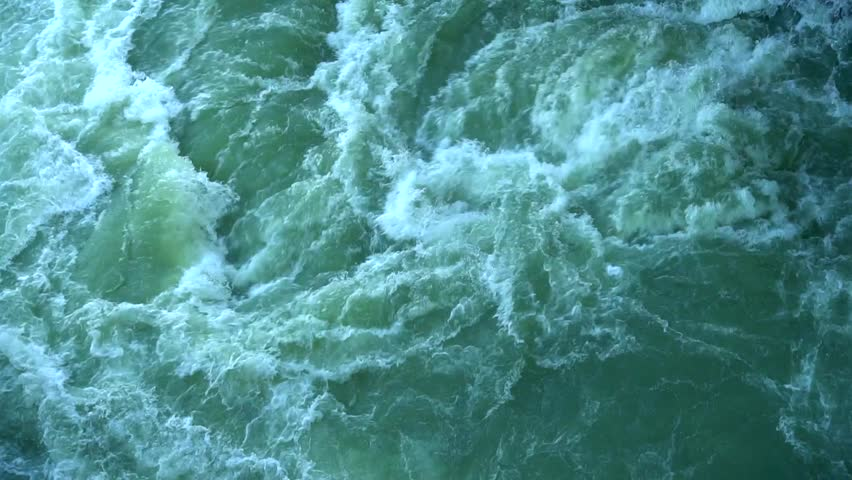 Aqua has emerald color and white foam.Water bubbles and creating small waves. Concept of water storm small save waves.  | Shutterstock HD Video #30094933