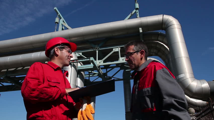 Industrial workers with clipboard working in power plant - Teamwork -  Engineer signing a document in power plant. HD1080p.