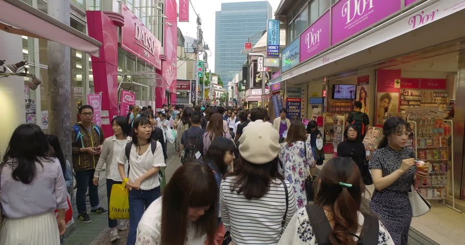 TOKYO - MAY 8, 2017: Point of view of someone walking along Takeshita Street in Harajuku, Tokyo, Japan capital city. This pedestrian shopping street is famous for trendy teenager fashion.
