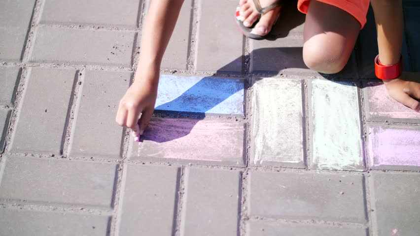 Close up, a girl in sunglasses, draw drawings with colored crayons on the asphalt, street tiles. A hot summer day. | Shutterstock HD Video #30110683