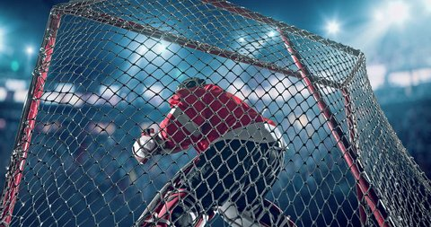Ice Hockey goalie saves a goal on a hockey arena with intensional lens flares. He is wearing unbranded sports clothes.