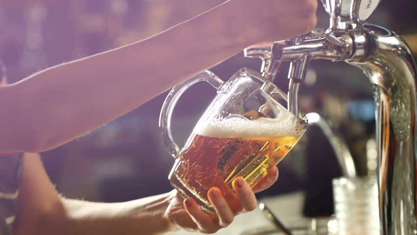 Craft beer poured into a glass. | Shutterstock HD Video #30155653
