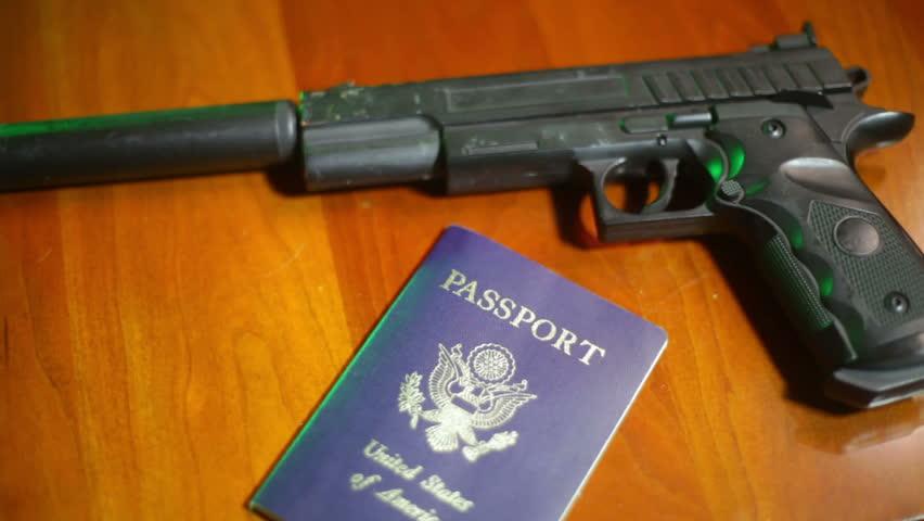secret agent, gun and passport