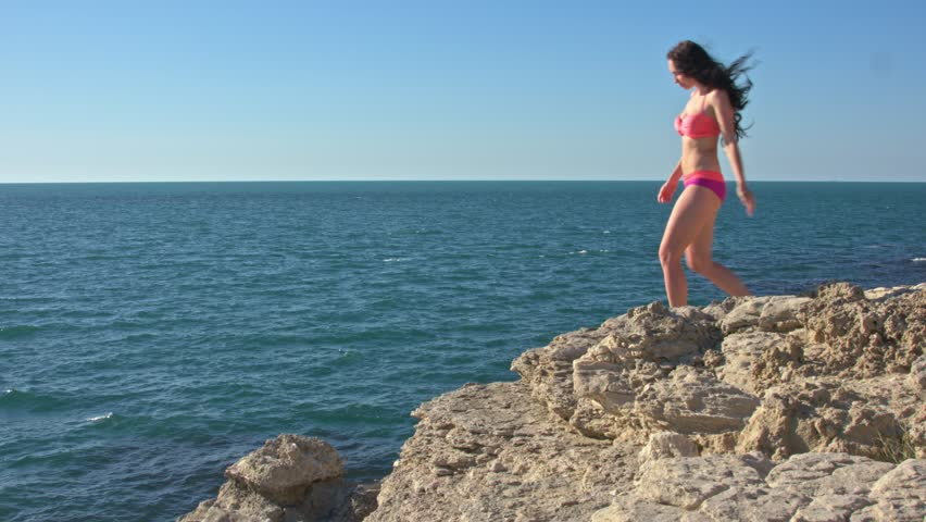 Girl on a rock by the sea #30226153