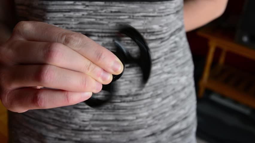 Woman playing fidget spinner | Shutterstock HD Video #30234793