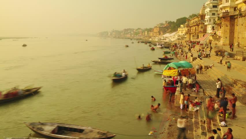 INDIA - NOVEMBER 21: Indian pilgrims rowing boat in sunrise, Ganges river on November 21, 2010 in Varanasi, India.