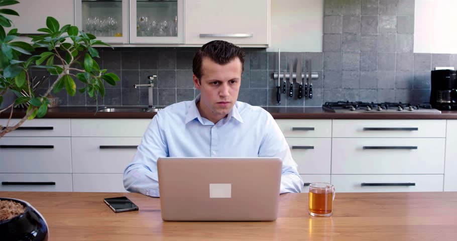 Young man working at home | Shutterstock HD Video #30242194