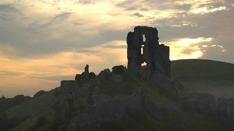 Sunrise over Corfe Castle, Dorset, England, UK.