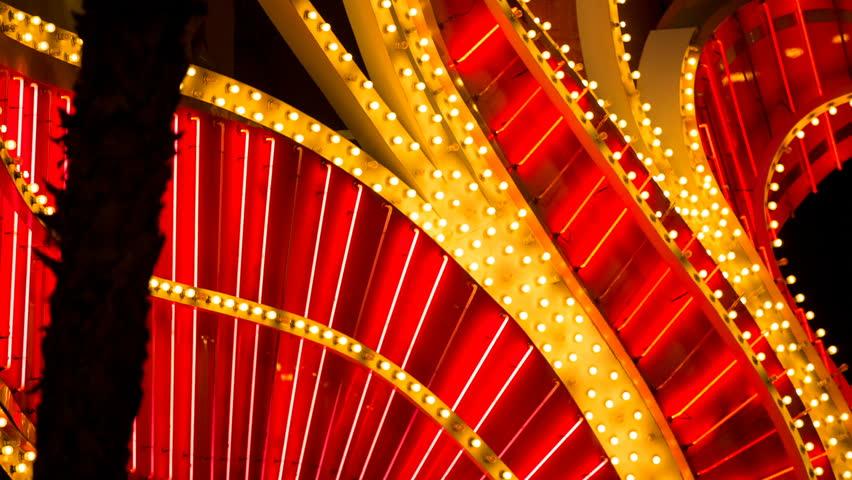 Red Neon Tube Design Casino Blinking Lights Detail. detail of a Las Vegas Casino neon lights and blinking bulbs  | Shutterstock HD Video #30281833