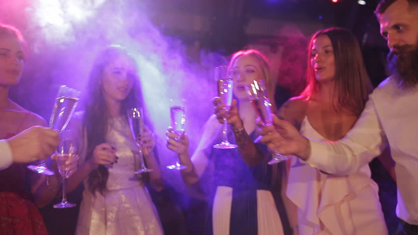 Friends drink champagne in the club at a friendly party #30300163