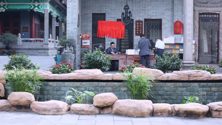 GUANGZHOU - NOV 24: Three chinese male reading in temple yard, on Nov 24,  2011 in Guangzhou, Guangdong, China. Temple of Six Banyan Trees, built in  537, ...