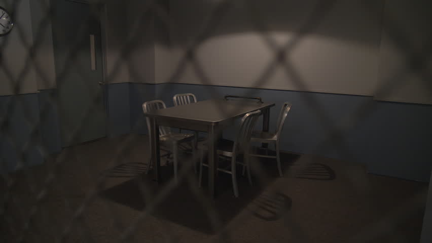 police interrogation room slow dolly move from behind a mesh barrier to an empty room