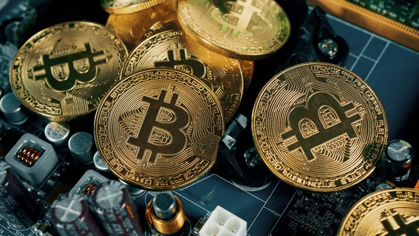 Crypto currency Gold Bitcoin - BTC - Bit Coin. Bitcoins on the motherboard. | Shutterstock HD Video #30316783