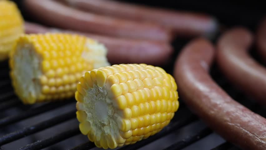 Boiled sweet yellow corn close up in pot stock footage video german sausages and corn on grill barbecue meal turn the corn and sausages during ccuart Choice Image