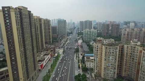 aerial view of Chengdu city in rush hours with heavy traffic on road and densely residential buildings in Sichuan China, Chinese urban drone footage