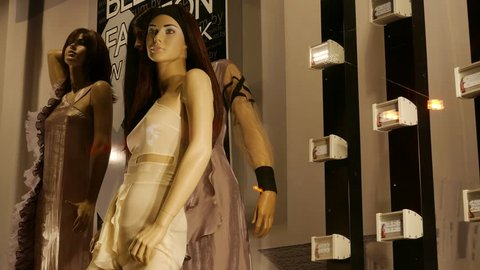 MINSK, BELARUS - MAR 14, 2017: Ungraded: Female mannequins in designer clothes are in the shop window next to the flashing LED bulbs. Ungraded H.264 from camera without re-encoding. (av40033u)