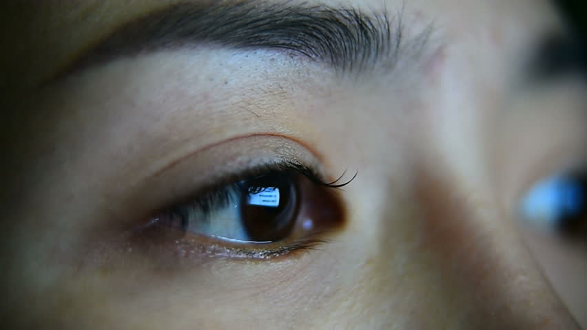 Close up of girl's eye surfing internet at night. | Shutterstock HD Video #30351013