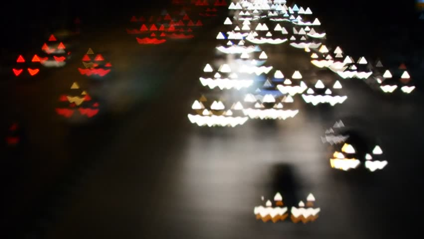 Pumpkin face bokeh light from cars in the street no sound
