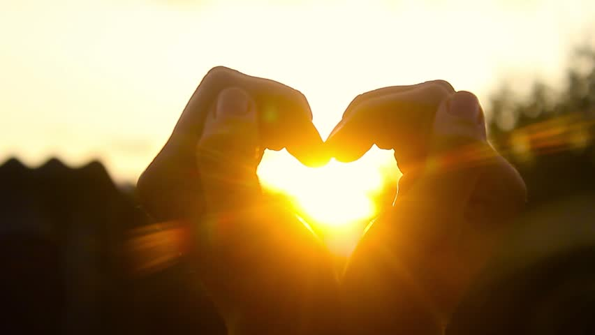 Hands forming a heart shape with sunset silhouette | Shutterstock HD Video #30356506
