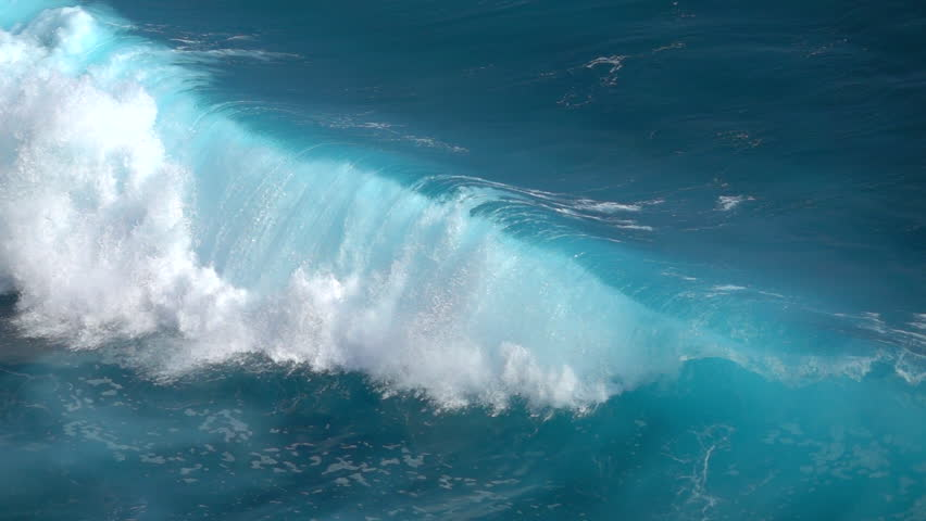 SLOW MOTION, CLOSE UP: Huge turbulent foamy ocean wave rising and breaking. Perfect barrel wave rolling upon the shore splashing. Big tube wave crushing, sea waterdrops spraying and sparkling in sun | Shutterstock HD Video #30367183