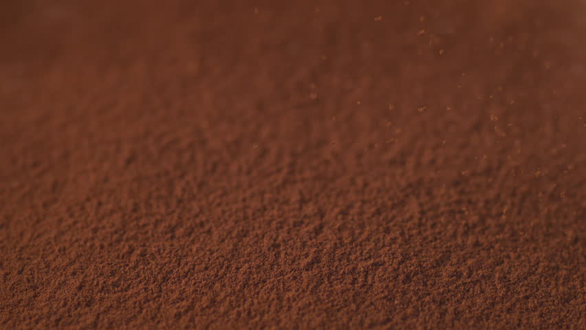 Sprinkling cinnamon powder. Shot with high speed camera, phantom flex 4K. Slow Motion.