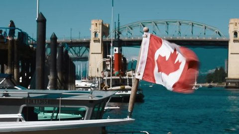 CIRCA SEPTEMBER 2017 - VANCOUVER ,CANADA - canadian flag with burrard bridge in background
