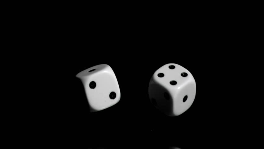 Two white dices in super slow motion rebonding against a black background