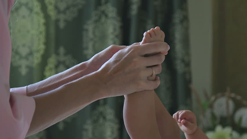 Mom Touches the child's Legs | Shutterstock HD Video #30449566