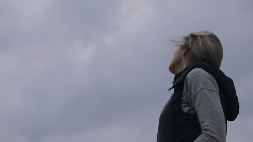 Cloudy, cold autumn day. Woman waiting her friend. Fresh air winds outdoor. #30455263