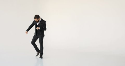 Businessman isolated shot in studio and isolated on a white background does various funny dances
