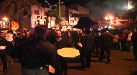 NABATIEH, LEBANON - CIRCA 2005: Ashura procession. Shia men are chanting and banging on drums. Ashura is the 10th day of Muharram in the Islamic calendar commemorating the death of Hussain Ibn Ali.