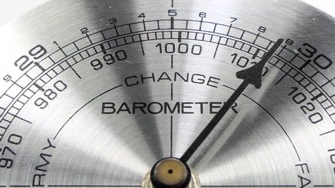 Barometer pointing towards weather change macro detail with zoom.