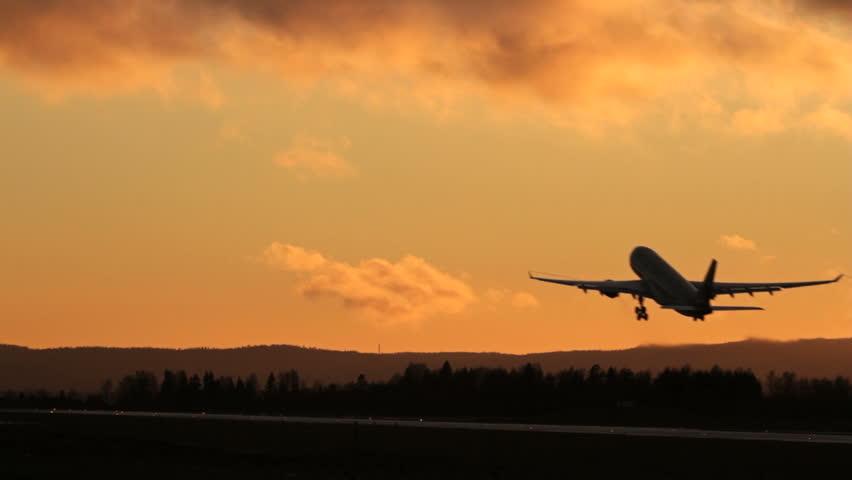 Airplane takeoff into evening sky