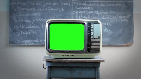 """80s TV with Green Screen in the Classroom. A Man Walking Behind. You can replace green screen with the footage or picture you want with """"Keying"""" effect in AE  (check out tutorials on YouTube)."""