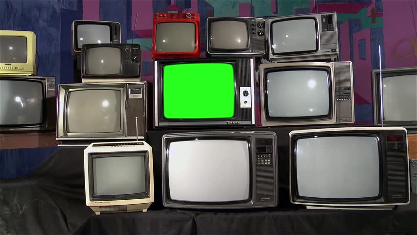 "Television Green Screen in the Middle of Many Tvs. Aesthetics of the 80s.You can replace green screen with the footage or picture you want with ""Keying"" effect in AE  (check out tutorials on YouTube)."