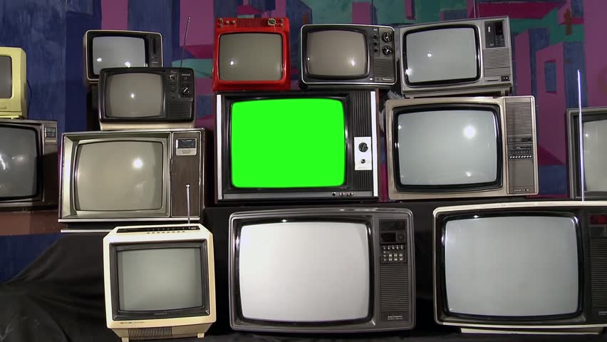 "Old TV with Green Screen and Many 80s TVS. Zoom In. You can Replace Green screen with the Footage or Picture you Want with ""Keying"" Effect (Check out Tutorials on YouTube). 