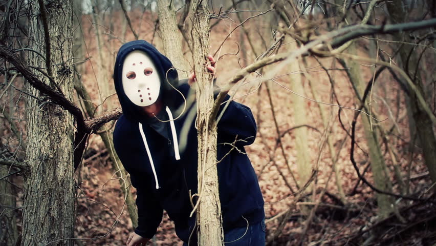 A masked killer stalks his victims on a wintery forest trail.