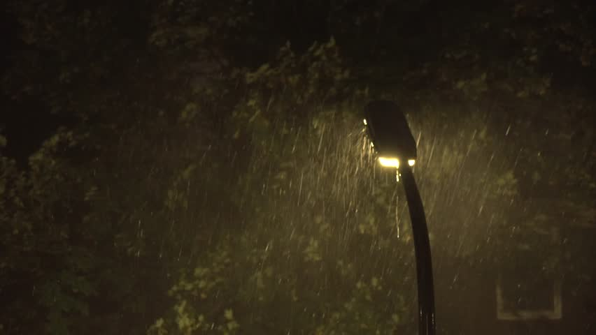 Streetlight In Massive Thunderstorm With Trees Moving Background