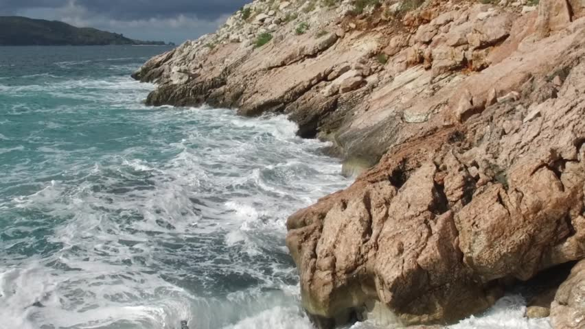 Rocks In Spanish Part - 43: The Waves Breaking On A Stony Beach, Forming A Spray. Footage. Splashing  Waves
