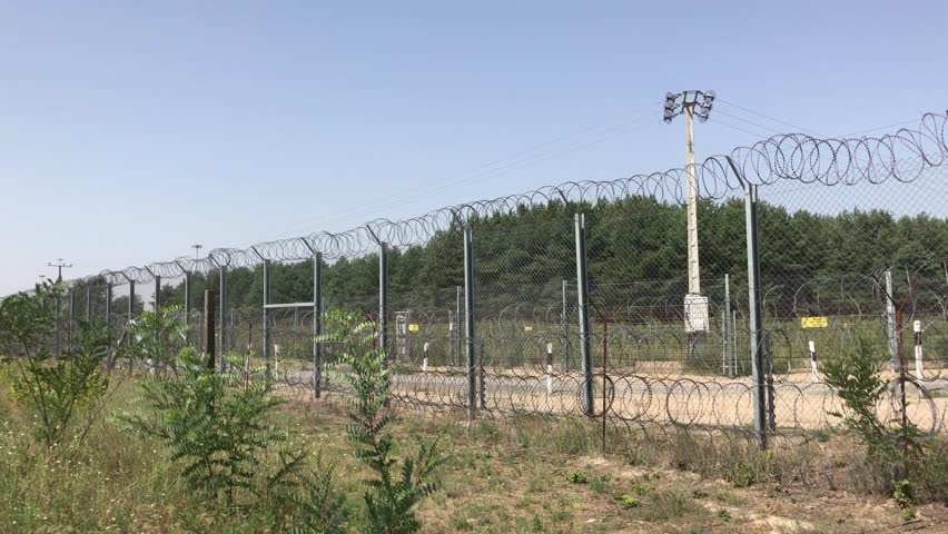 Subotica, Serbia - August 07, 2017: Several lines of oval razor barbed wire on The Serbian-Hungarian border
