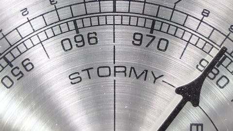 Barometer pointing towards stormy weather macro detail with zoom.