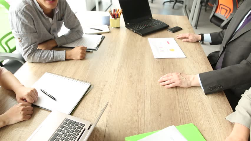 Close up view of business team sitting at the table in the office, folding hands. Work is done, happy coworkers holding hands together. | Shutterstock HD Video #30656563