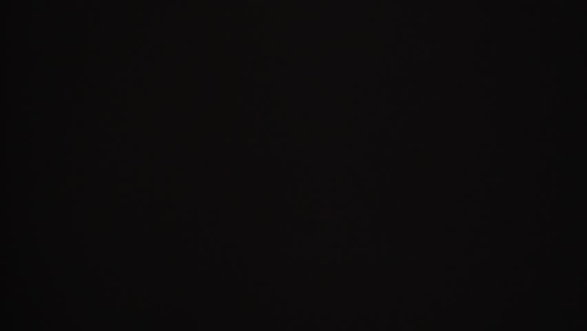 Fx Light Steady Stream Of Gravel Falling Against Black