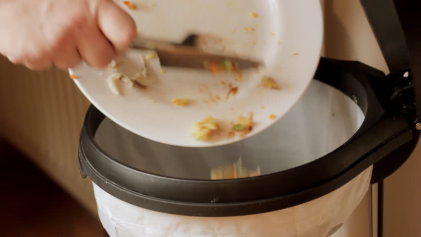 Scraping leftover meal into bin