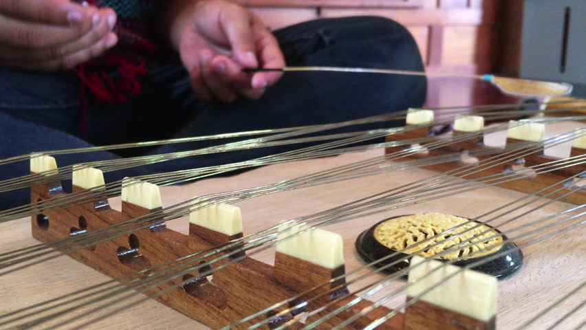 In Selective Focus of closeup Woman Wearing Jeans During Playing the Dulcimer Thai Music.Thai musical instruments.  | Shutterstock HD Video #30680023
