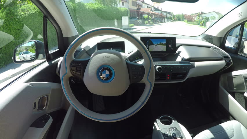 Ljubljana, Slovenia, 7th September 2017: CLOSE UP POV, Futuristic computer sensor robotic technology controlling futuristic self-driving self-steering automated autonomous electric car BMW i3.