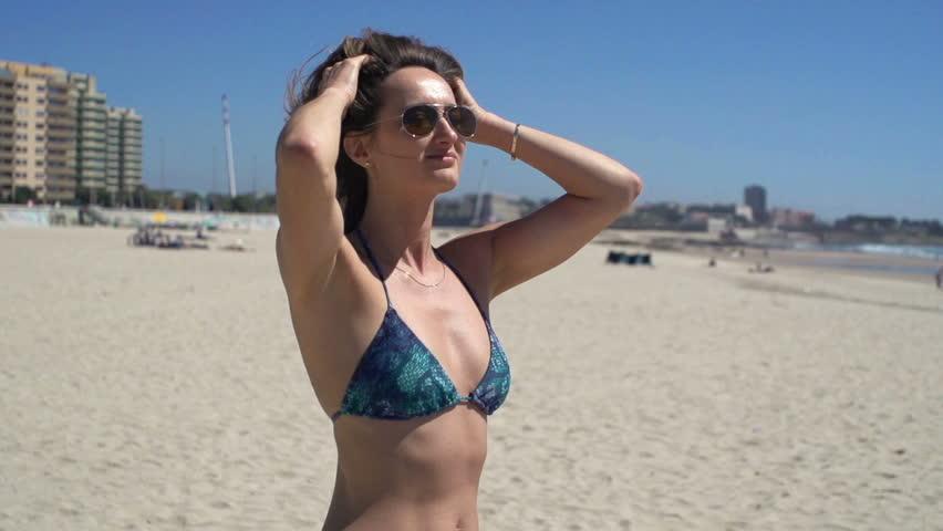 Happy woman in bikini with wide open arms enjoying sunny day on beach  | Shutterstock HD Video #30713104
