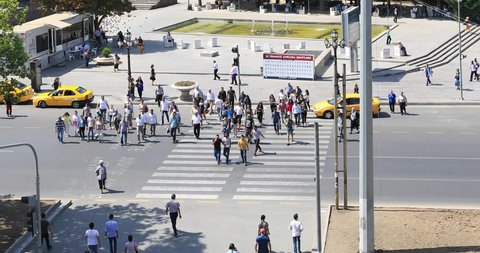 ANKARA, TURKEY - SEPTEMBER 05, 2017: Kizilay square and skyscraper, Ankara capital of Turkey , Ankara.  Ataturk street with lots of walking people crossing the road