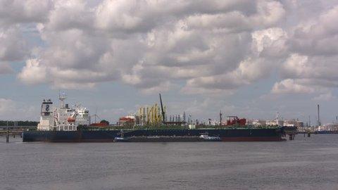ROTTERDAM SEAPORT- AUGUST 2017: Crude oil tanker Navig8 Excelsior discharging at Europoort + bunker ship