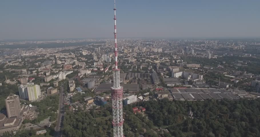 Aerial TV tower. TV tower in Kiev 01.August. 2017. Close to residential buildings and highway.Digital television broadcasting and surveillance Tower restaurant city skyline Kiev, Ukraine. Summer sunny | Shutterstock HD Video #30746773